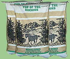 Bags of Top Of The Rockies alfalfa horse cubes.